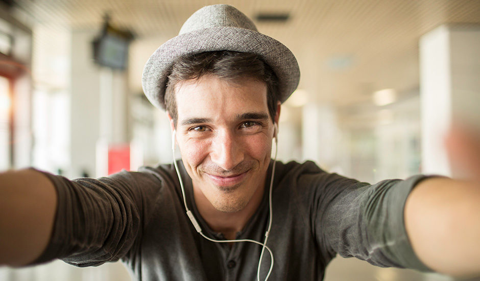 Blog featured image: A smiling man taking a selfie