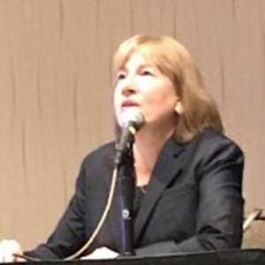 Carol Dobak talks in a panel